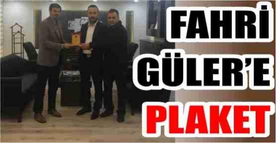 FAHRİ GÜLER'E PLAKET