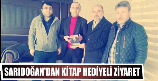 Sarıdoğan'dan kitap hediyeli ziyaret