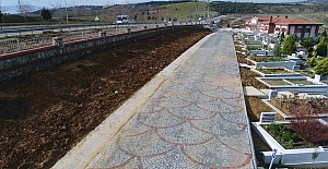 Mezarlıklara 14 bin metre taş duvar...