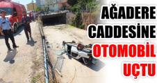 AĞADERE CADDESİNE OTOMOBİL UÇTU