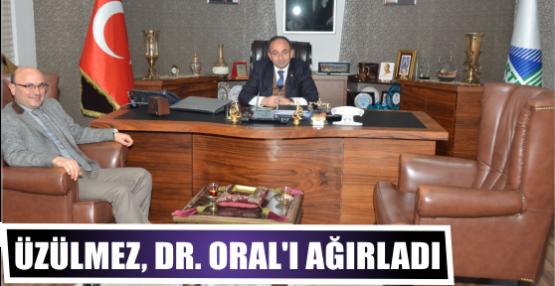 ÜZÜLMEZ, DR. ORAL'I AĞIRLADI